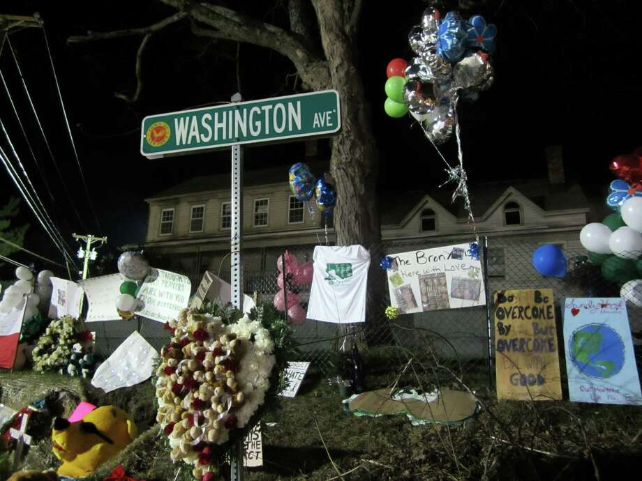 These are a few of the signs at a huge memorial about a quarter mile from for the Sandy Hook Elementary School, where 20 students and six teachers were killed Dec. 14. Hundreds of mourners gathered there for days after the shooting, but access to the school was limited to authorities. Photo: Casey McNerthney/Hearst Newspapers