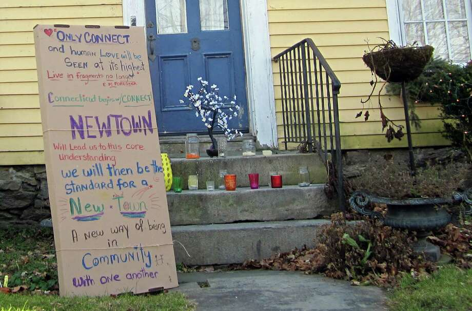 A neighbor made this sign across from Honan Funeral Home on Newtown's Main Street. The funeral home held wakes for many of the 20 children killed in the Dec. 14 massacre. Photo: Casey McNerthney/Hearst Newspapers