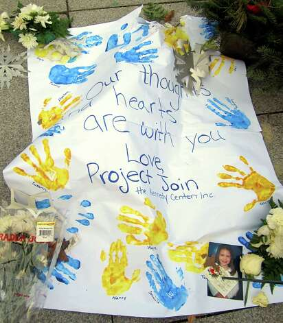 This children's card was part of a large memorial outside Newton's Edmond Town Hall. The picture was taken Dec. 20, the same day four of the 20 schoolchildren killed and two of the six teachers had funerals. Photo: Casey McNerthney/Hearst Newspapers