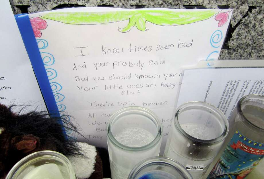 This card from a child was part of a large memorial outside Newton's Edmond Town Hall. The picture was taken Dec. 20, the same day four of the slain schoolchildren killed and two of their teachers had funerals. Photo: Casey McNerthney/Hearst Newspapers