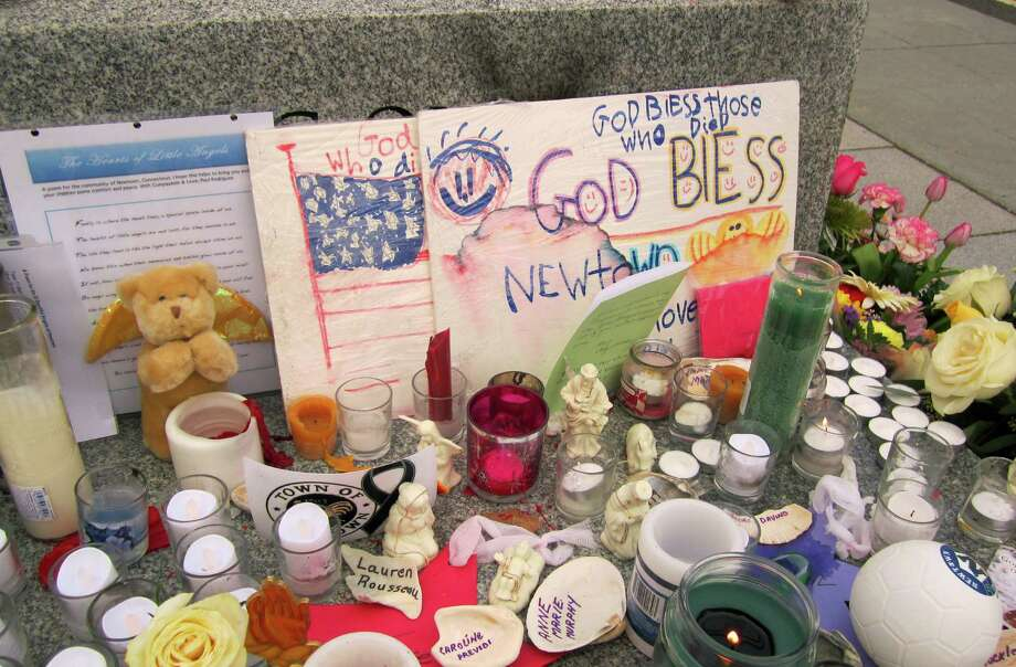 This was part of a large memorial outside Newton's Edmond Town Hall. The picture was taken Dec. 20, the same day four of the slain schoolchildren killed and two of their teachers had funerals. Photo: Casey McNerthney/Hearst Newspapers