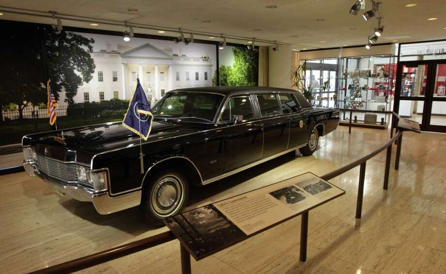 LBJ's limousine has moved to the lobby in front of the gift shop. Photo: Erich Schlegel, Houston Chronicle / ©2012 Erich Schlegel