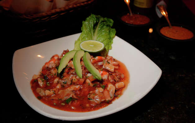 Dining review of Cielito Lindo in Stone Oak on Tuesday, Jan. 4, 2011. Featured dish: Vuelve a la Vida cocktail. The restaurant has been in business for seven years and was listed in as one of Texas Monthly's best 50 Mexican restaurants in 2010. Kin Man Hui/kmhui@express-news.net Photo: KIN MAN HUI, SAN ANTONIO EXPRESS-NEWS / kmhui@express-news.net