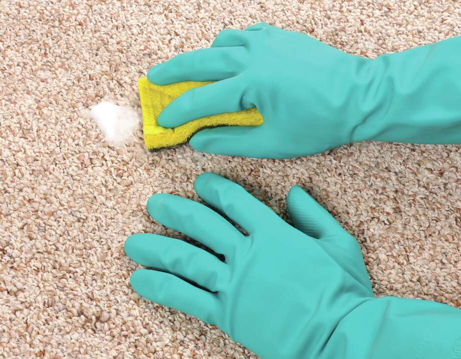 How to clean a carpet spot. (Fotolia.com) / Stephen VanHorn - Fotolia