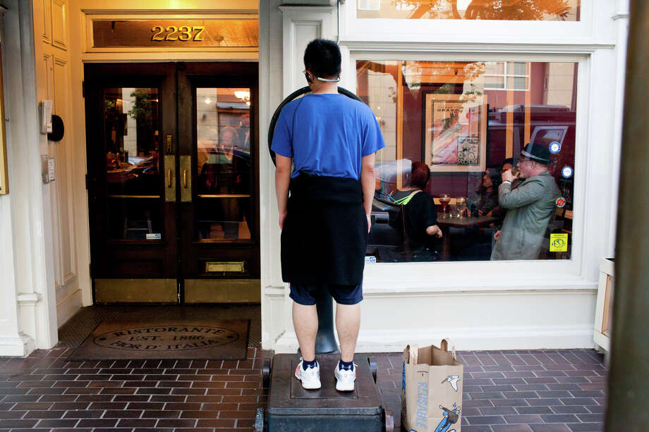 Hugh Ng, a neighborhood resident, weighs himself on the scale Photo: Jason Henry, Special To The Chronicle / ONLINE_YES