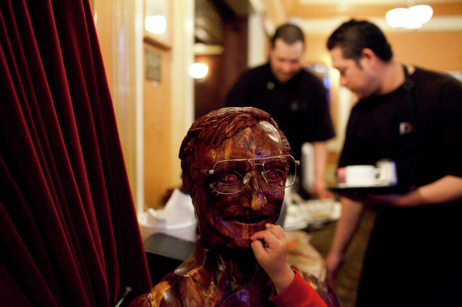 Liam Liope touches a wooden sculture of head chef Gianni Audieri Photo: Jason Henry, Special To The Chronicle / ONLINE_YES