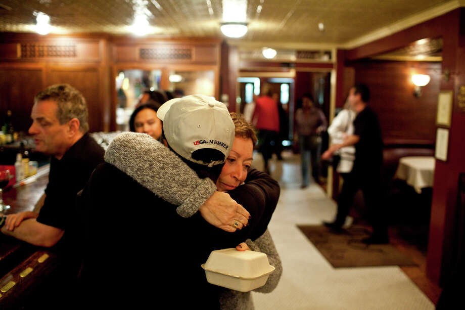 Long-time neighborhood patrons Rose Lorella and Everett Davis hug each other during the last night Photo: Jason Henry, Special To The Chronicle / ONLINE_YES