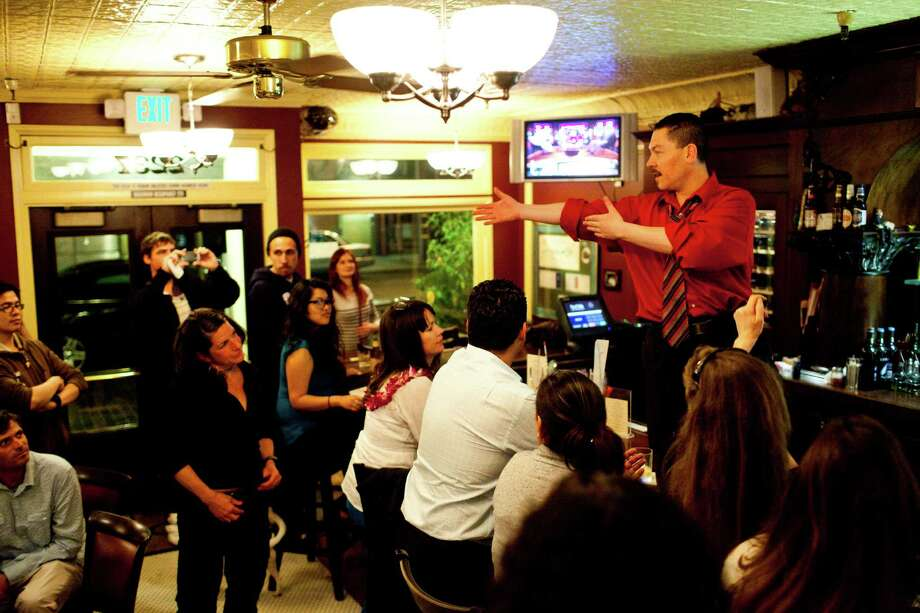 Bartender Giovanni Rivas makes a farewell speech to patrons and staff during the last night Photo: Jason Henry, Special To The Chronicle / ONLINE_YES