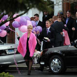 Lynn and Chris McDonnell carry pink and purple balloons following a Memorial Mass for their daughter, Grace McDonnell, a student victim of the Newtown shootings, Friday, Dec. 21, 2012 at St. Rose of Lima Roman Catholic Church in Newtown, Conn.