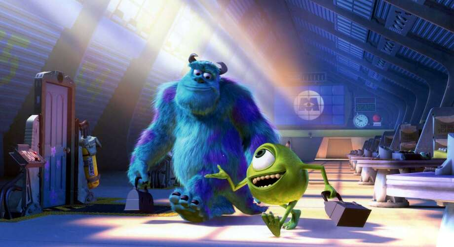 Sulley (left) and Mike (right) in Disney/Pixar's new animated feature, 'Monsters, Inc.' Featuring the voices of John Goodman and Billy Crystal.  (AP Photo/Disney/Pixar)