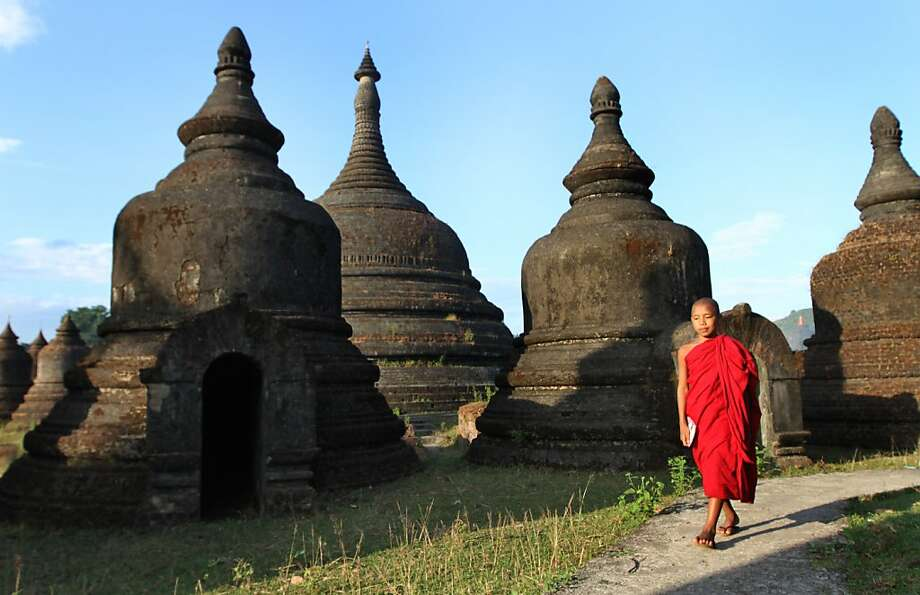 A Buddhist monk walks along ancient pagodas in Mrauk-U in western Burma. The Asian country has only recently fully opened to tourism. Photo: Khin Maung Win, Associated Press