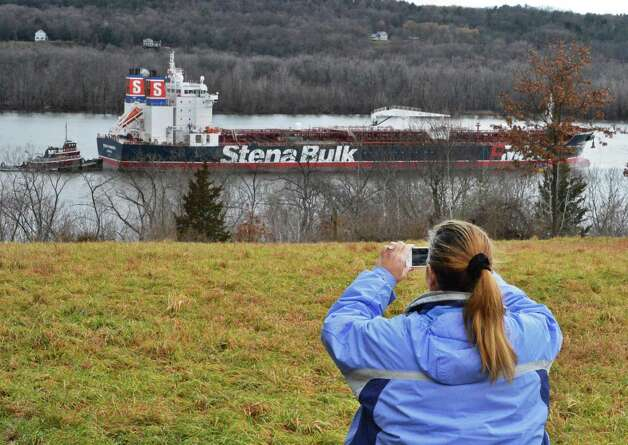 "Kara Udwary of Stuyvesant takes a picture of the oil tanker ""Stena Primorsk"" carrying North Dakota crude from the Port of Albany at anchor in the Hudson River off Stuyvesant Friday Dec. 21, 2012, after running aground yesterday morning.  (John Carl D'Annibale / Times Union) Photo: John Carl D'Annibale / 00020553A"