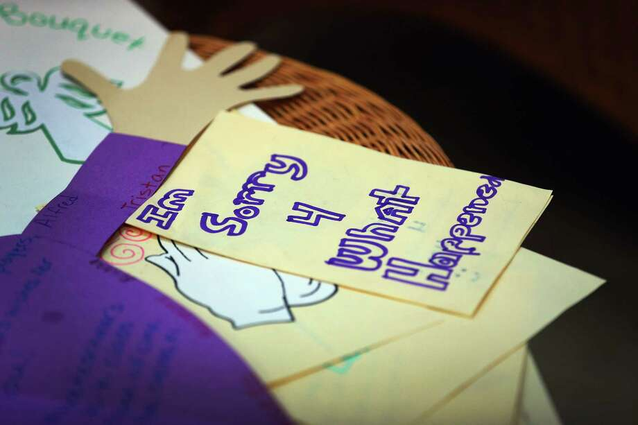 MIAMI, FL - DECEMBER 21:  A card written by a student at St. Rose of Lima School reads, ''Im Sorry 4 What Happened'' on a card to be sent to the victims of  the school shooting in Newtown, Connecticut on December 21, 2012 in Miami, Florida. Across the country people marked the one week point since the shooting at Sandy Hook Elementary School in Newtown, Connecticut that killed 26 people.  (Photo by Joe Raedle/Getty Images) Photo: Joe Raedle, Getty Images / Getty Images