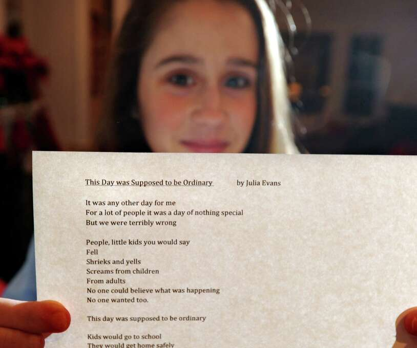 "Julia Evans, 12, of Old Greenwich, holds her poem about the Sandy Hook Elementary School massacre titled ""The Day was Suppose to be Ordinary,"" at her home, Thursday night, Dec. 20, 2012. Evans is a 7th grader at Greenwich Country Day School. Photo: Bob Luckey / Greenwich Time"
