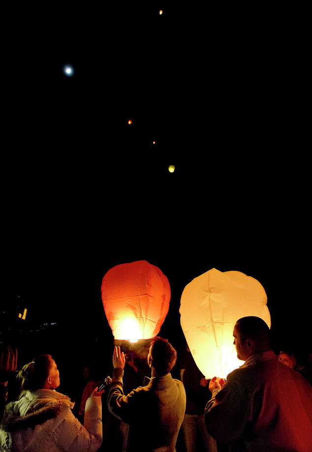 Mourners release lanterns during the community memorial vigil at Ben Lomond High School in Ogden for Emilie Parker, one of the children murdered during the recent school shooting at Sandy Hook Elementary, Thursday, Dec. 20, 2012. (AP Photo/Deseret News, Ben Brewer) Photo: Ben Brewer, Associated Press / Associated Press