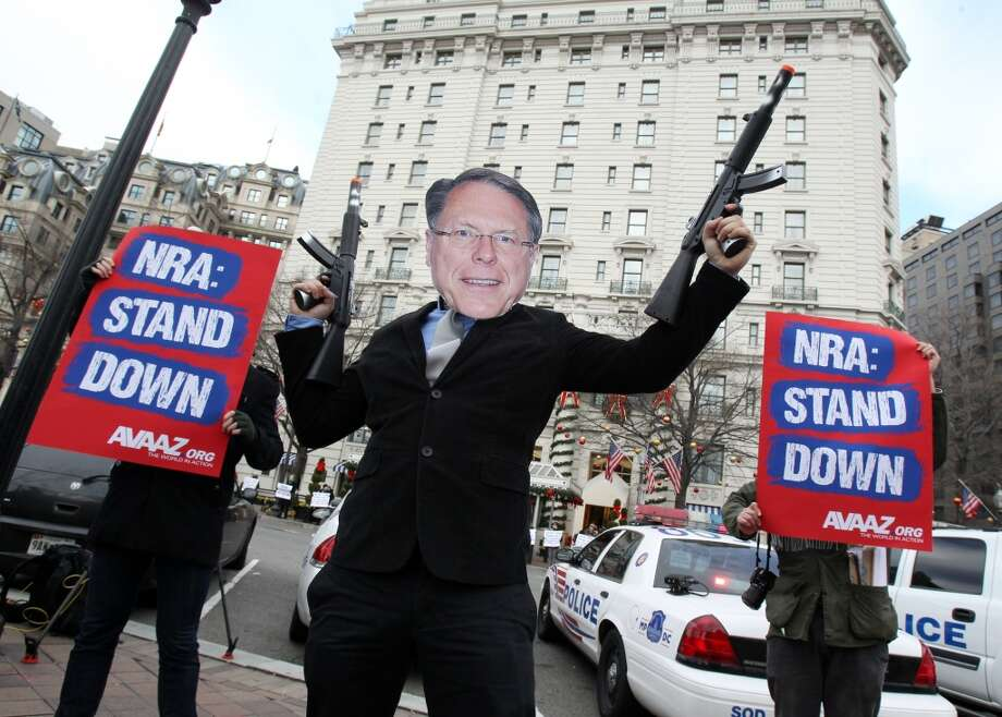 Members of the activist group Avaaz protest today's NRA press conference with a likeness of NRA CEO Wayne LaPierre Jr., calling on NRA affiliates like Days Inn and Super 8 to get out of bed with the gun lobby, outside the Willard Hotel in Washington, Friday, Dec. 21, 2012. (Paul Morigi / AP)