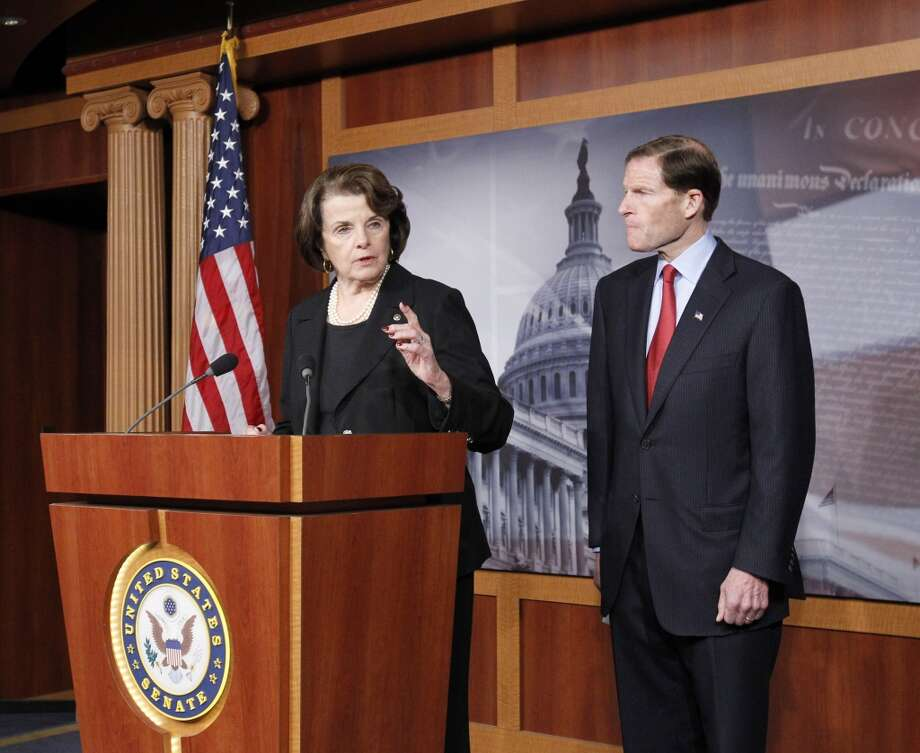 Sen. Diane Feinstein, D-Cal., left, speaks as she and Sen. Richard Blumenthal, D-Conn., right, discuss proposals made by the NRA in response to the Connecticut school shooting, in Washington, Friday, Dec. 21, 2012, during a news conference on Capitol Hill.  (Ann Heisenfelt / AP)