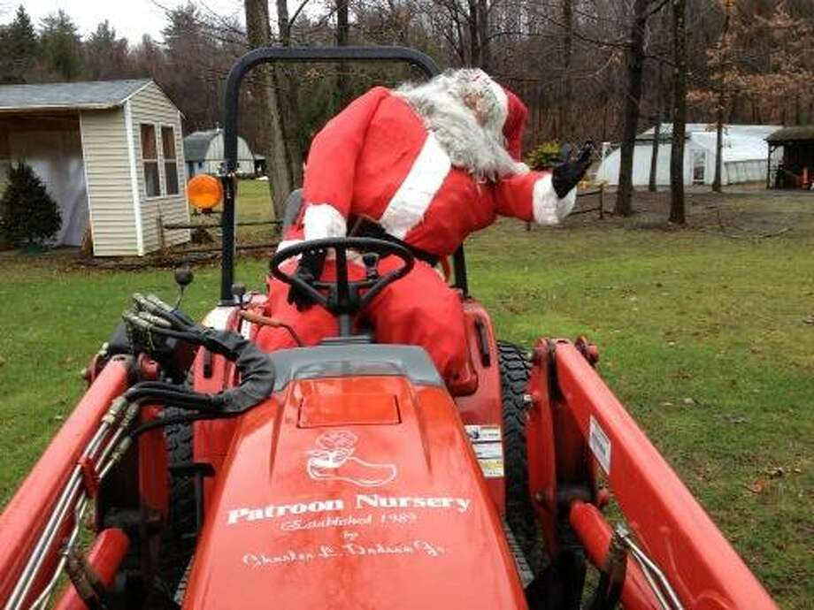 Even Santa almost fell off his tractor from the high winds in West Sand Lake on Friday, Dec. 21, 2012. (Lori Van Buren/Times Union)