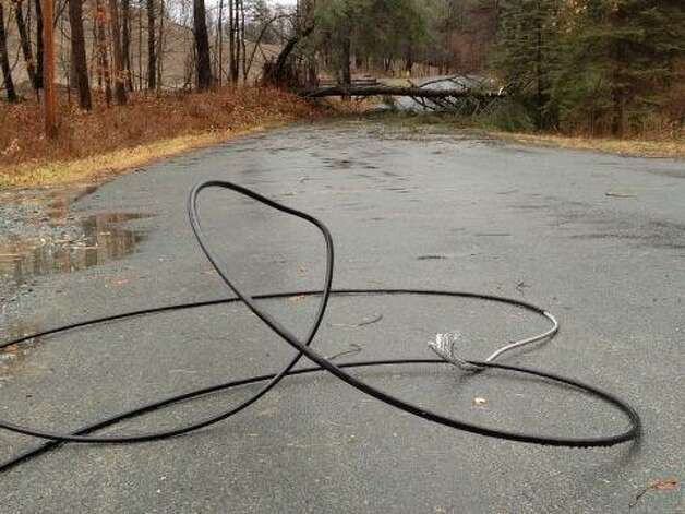 Downed wires and a downed tree close Springer Road in West Sand Lake on Friday, Dec. 21, 2012. (Lori Van Buren/Times Union)