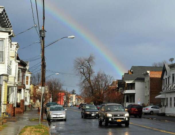 A rainbow over Fifth Avenue in Lansingburgh Friday morning Dec. 21, 2012.  (John Carl D'Annibale / Times Union) Photo: John Carl D'Annibale