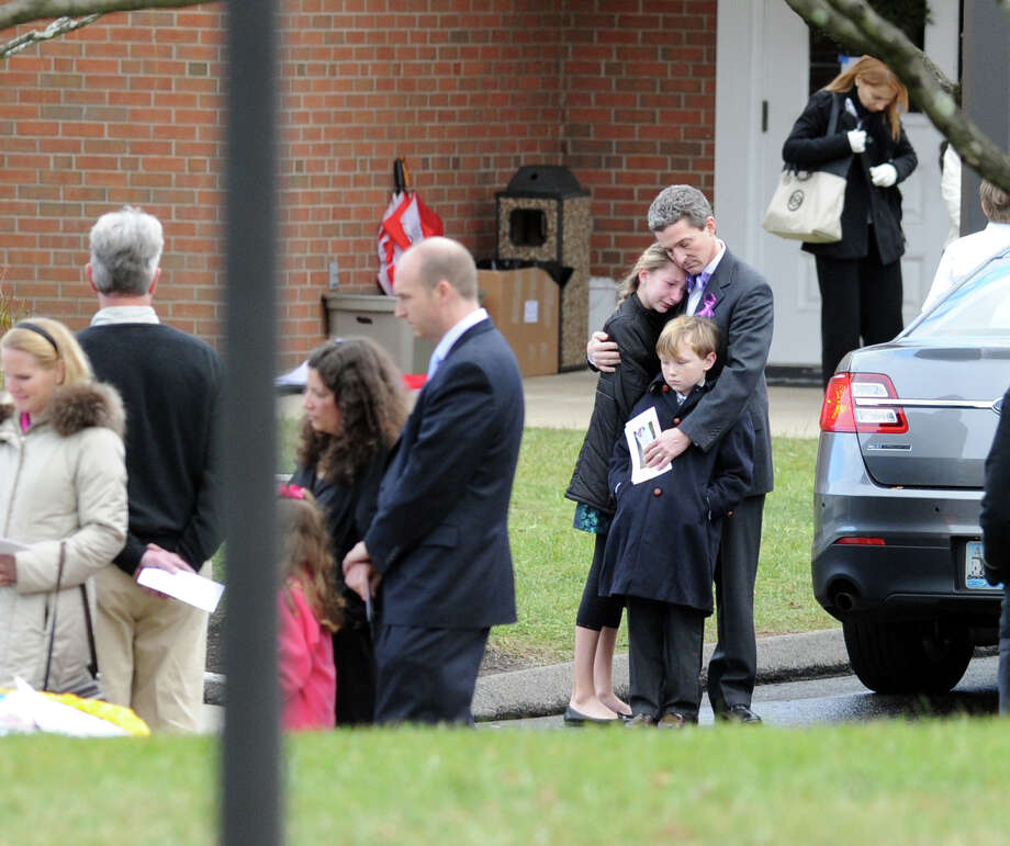 Mourners at the conclusion of the Funeral Mass for Sandy Hook Elementary School student Olivia Rose Engel at St. Rose of Lima Roman Catholic Church in Newtown, Friday afternoon, Dec. 21, 2012. Photo: Bob Luckey / Greenwich Time