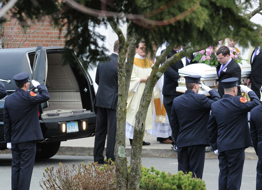 The casket of Sandy Hook Elementary School student Olivia Rose Engel is carried to the hearse at the conclusion of the Funeral Mass for her at St. Rose of Lima Roman Catholic Church in Newtown, Friday afternoon, Dec. 21, 2012. Photo: Bob Luckey / Greenwich Time