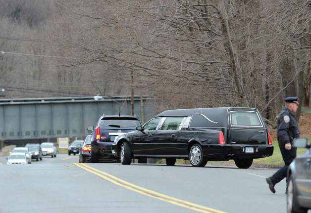 The hearse carrying Sandy Hook Elementary School student Olivia Rose Engel leaves the St. Rose of Lima Roman Catholic Church at the conclusion of her Funeral Mass in Newtown, Friday afternoon, Dec. 21, 2012. Photo: Bob Luckey / Greenwich Time