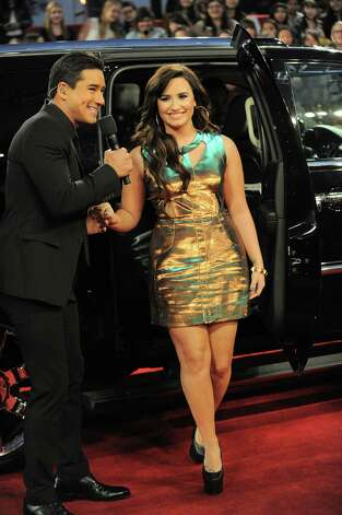 "Demi Lovato arrives at the ""The X Factor"" season finale results show at CBS Television City on Thursday, Dec. 20, 2012, in Los Angeles. (Photo by Jordan Strauss/Invision/AP) Photo: Jordan Strauss"