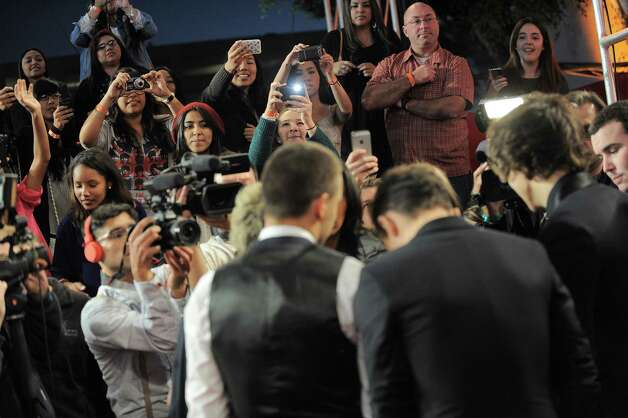 "Fans take pictures as One Direction arrives at the ""The X Factor"" season finale results show at CBS Television City on Thursday, Dec. 20, 2012, in Los Angeles. (Photo by Jordan Strauss/Invision/AP) Photo: Jordan Strauss"