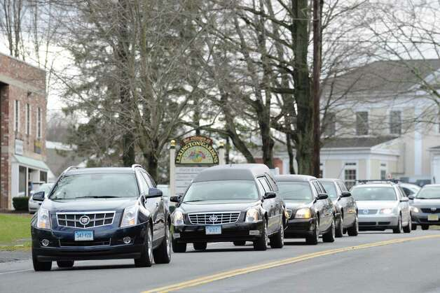 The hearse carrying Sandy Hook Elementary School student Olivia Rose Engel enters the St. Rose of Lima Roman Catholic Church at the conclusion of her Funeral Mass in Newtown, Friday afternoon, Dec. 21, 2012. Photo: Bob Luckey / Greenwich Time