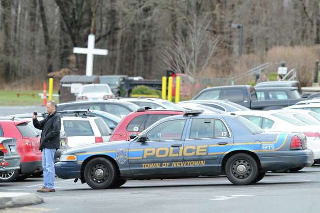 A Newtown police car at the Funeral Mass for Sandy Hook Elementary School student Olivia Rose Engel at St. Rose of Lima Roman Catholic Church in Newtown, Friday afternoon, Dec. 21, 2012. Photo: Bob Luckey / Greenwich Time