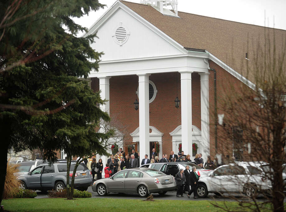 Mourners exit the funeral of James R. Mattioli, one of the children killed in the Sandy Hook Elementary School shootings, at St. Rose of Lima Catholic Church in Newtown on Tuesday, December 18, 2012. Photo: Brian A. Pounds / Connecticut Post