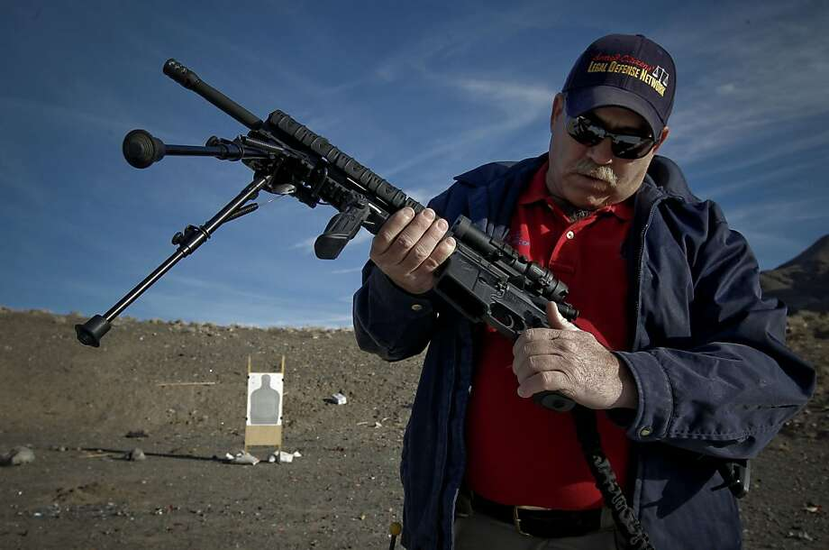 Kevin Roth, owner of Arms to Bear, is a firearms trainer, gun dealer and active shooter. He loads his AR-15 with cartridges as he prepares to do some target practice at an informal shooting range just outside of Sparks, Nev. Photo: Michael Macor, The Chronicle