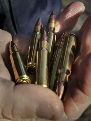 Roth shows the 6.8 special-purpose cartridges that he uses in his AR-15 assault rifle, firing eight rounds in four seconds. Photo: Michael Macor, The Chronicle