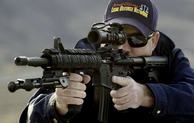 Roth aims his AR-15 assault rifle during target practice. The weapon can carry 30 rounds in a detachable magazine. Photo: Michael Macor, The Chronicle