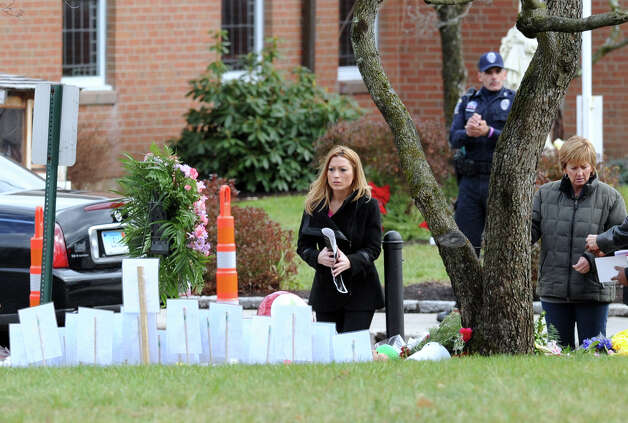 Mourners at the Funeral Mass for Sandy Hook Elementary School student Olivia Rose Engel at St. Rose of Lima Roman Catholic Church in Newtown, Friday afternoon, Dec. 21, 2012. Photo: Bob Luckey / Greenwich Time