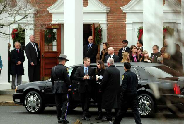 Family members arrive at the funeral for Jessica Rekos, one of 20 children killed in a mass shooting at Sandy Hook Elementary School Friday morning, Tuesday, Dec. 18, 2012 at St. Rose of Lima Roman Catholic Church in Newtown, Conn. Photo: Autumn Driscoll / Connecticut Post