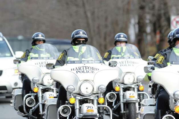 Hartford Police motorcycle officers at the Funeral Mass for Sandy Hook Elementary School student Olivia Rose Engel at St. Rose of Lima Roman Catholic Church in Newtown, Friday afternoon, Dec. 21, 2012. Photo: Bob Luckey / Greenwich Time