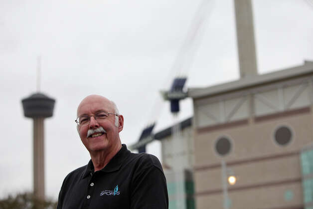 Bill Hanson stands outside the Alamodome on Friday, Dec. 14, 2012. He will retire as Associate Executive Director of San Antonio Sports on Dec. 31. Photo: LISA KRANTZ, San Antonio Express-News / SAN ANTONIO EXPRESS-NEWS