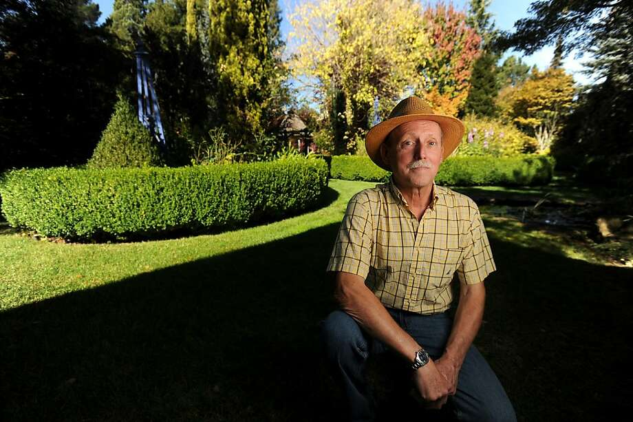 Freeland Tanner, above, and his wife, Sabrina, care for their 1-acre garden in Napa filled with Tanner's artwork (top and below) and over 700 varieties of plants. Photo: Noah Berger, Special To The Chronicle