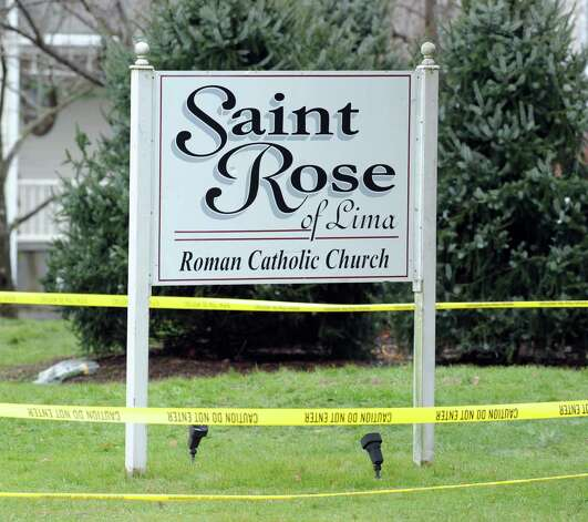 The sign for the St. Rose of Lima Roman Catholic Church during the Funeral Mass for Sandy Hook Elementary School student Olivia Rose Engel  in Newtown, Friday afternoon, Dec. 21, 2012. Photo: Bob Luckey / Greenwich Time