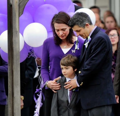 Nicole and Ian Hockley stand with their son Jake, as they wait to release 26 balloons in memory of the 26 victims of the Sandy Hook Elementary School shooter. A funeral service for their son, and Jake's brother, Dylan Hockley, one of the victims, was held at Walnut Hill Community Church in Bethel, Conn. Friday, Dec. 21, 2012. Photo: Carol Kaliff / The News-Times