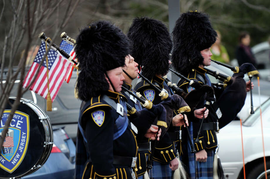Members of the New York Port Authority Police Pipes and Drum Corps. perform during a funeral service for Dylan Hockley Friday. The funeral service for Dylan, a victim of the Sandy Hook Elementary School shootings last week, was held at Walnut Hill Community Church in Bethel, Conn. Friday, Dec. 21, 2012. Photo: Carol Kaliff / The News-Times