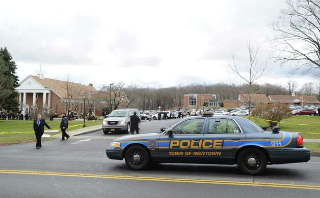 A Newtown police car during the Funeral Mass for Sandy Hook Elementary School student Olivia Rose Engel at St. Rose of Lima Roman Catholic Church in Newtown, Friday afternoon, Dec. 21, 2012. Photo: Bob Luckey / Greenwich Time