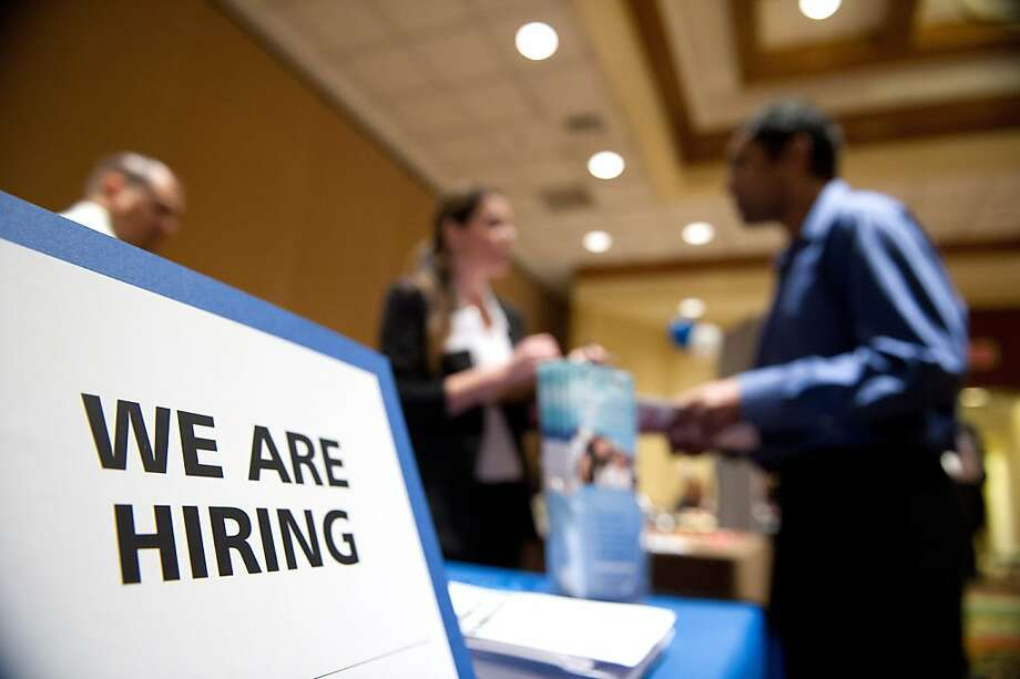 A job seeker (right) speaks with a recruiter during a recent HIREvent job fair in San Jose. Photo: David Paul Morris, Bloomberg