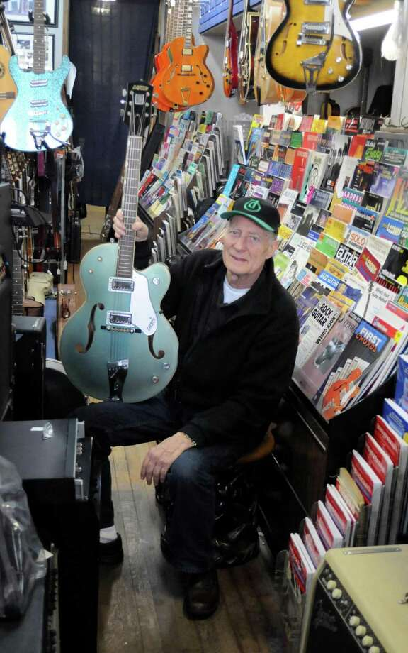 "Russ Mumma owns the Music Guild on Main Street in Danbury.  Here he holds one of the vintage instruments, a 1958 Gretsch guitar, that was used in the film ""Not Fade Away"" which opened Friday, Dec. 21, 2012. Photo: Lisa Weir / The News-Times Freelance"