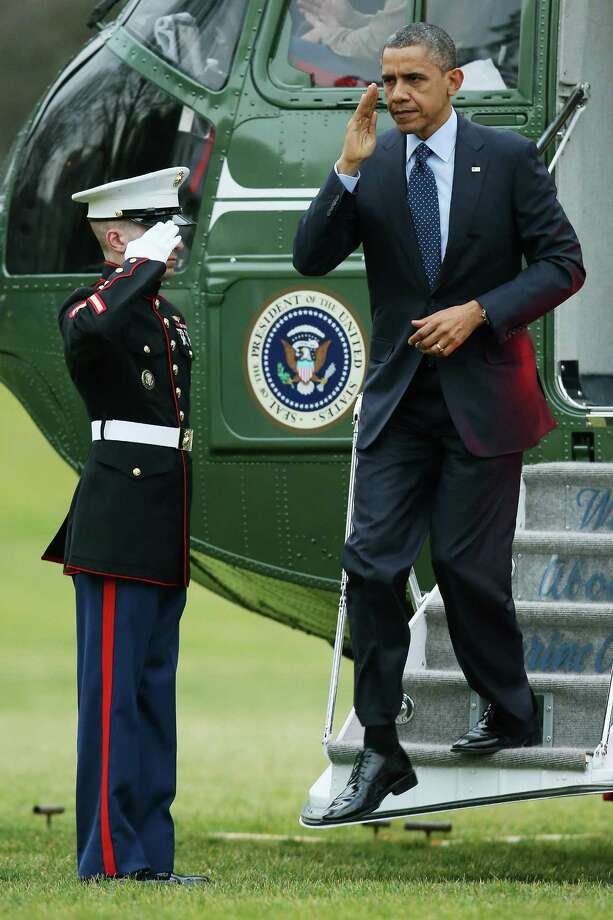U.S. President Barack Obama disembarks from Marine One on the South Lawn of the White House last week.  Obama should make  addressing plight of black men in America a major issue. Photo: Chip Somodevilla, Getty Images / 2012 Getty Images