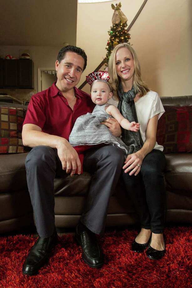 Russell Reyes and Sarah Pruski will celebrate daughter Eviana Reyes' first birthday on New Year's Day. The couple has planned the big celebration for Dec. 29 to accommodate partygoers. Photo: Michael Miller, For The Express-News / San Antonio Express-News