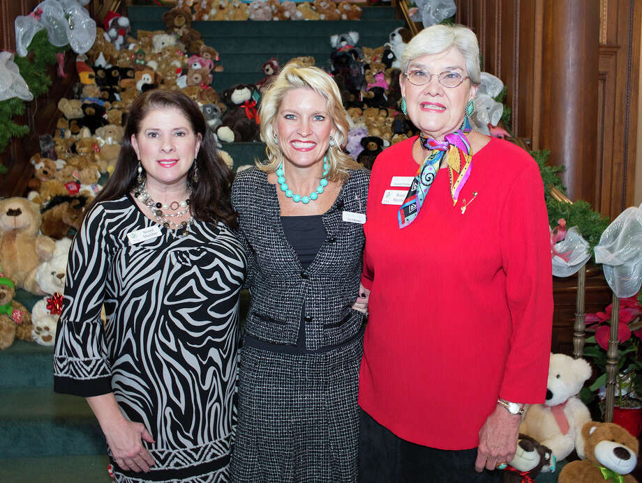 Historian Tina Magness, from left, First Vice President Joy Fuhrmann  and President Harriett Ellerbee get together during the Zeta Tau Alpha  Teddy Bear Tea at the San Antonio Woman's Club. Photo: J. Michael Short, For The Express-News / THE SAN ANTONIO EXPRESS-NEWS