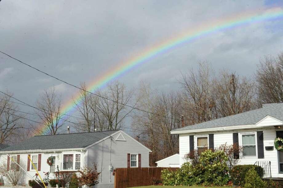 A rainbow is seen over a neighbor hood during a wind and rain storm on Friday Dec. 21, 2012 in Troy, N.Y.  (Lori Van Buren / Times Union) Photo: Lori Van Buren